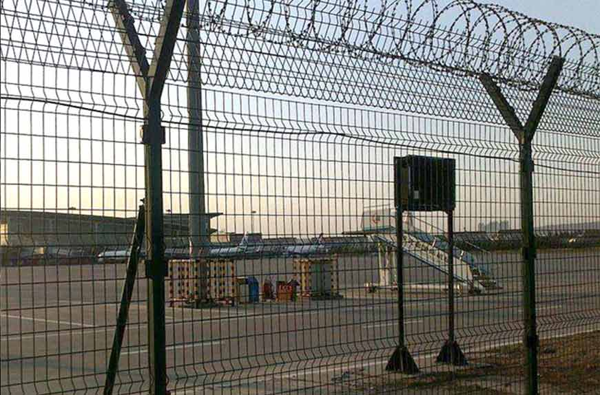 High security airport fence with razor barbed